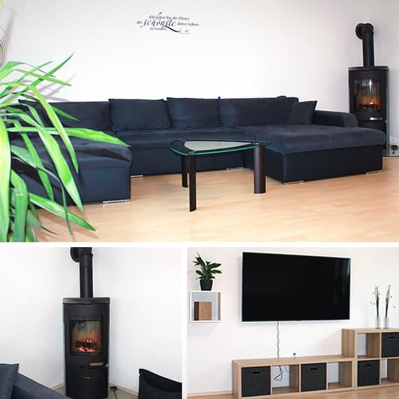 Wohnzimmer mit Schwedenofen und TV-Wand
